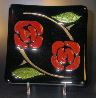 "NOUVEAU ROSE D'OR 6"" sushi style black dish or plate with lightly fused roses and leaves. The stems were sandblasted and inlaid with 23kt gold."