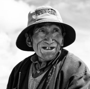 a black and white photograph of a farmer in the developing world