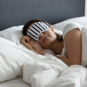 white woman sleeping with an eye mask