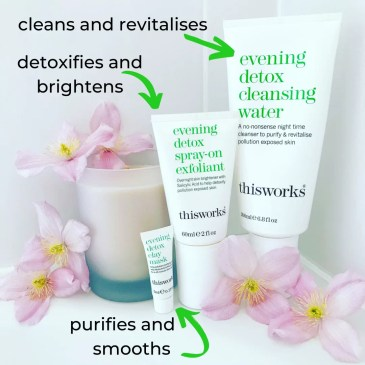 bathroom image showing white tiles and the corner of a bath, on this stands a large white candle and all three detox products, half a dozen pink flowers are dotted in between. The products have annotations and arrows: cleans and revitalises (cleanser), detoxifies and brightens (exfoliator), purifies and smooths (mask)