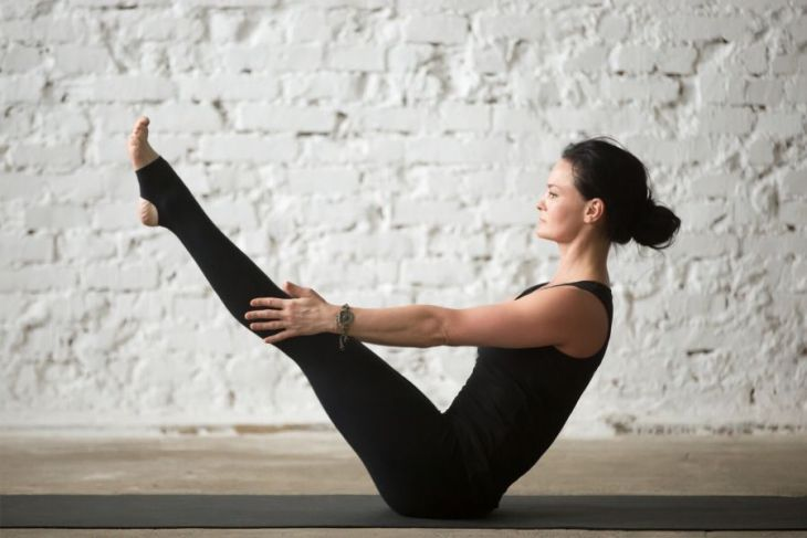 Boat Pose supports self-confident posture through core strength.