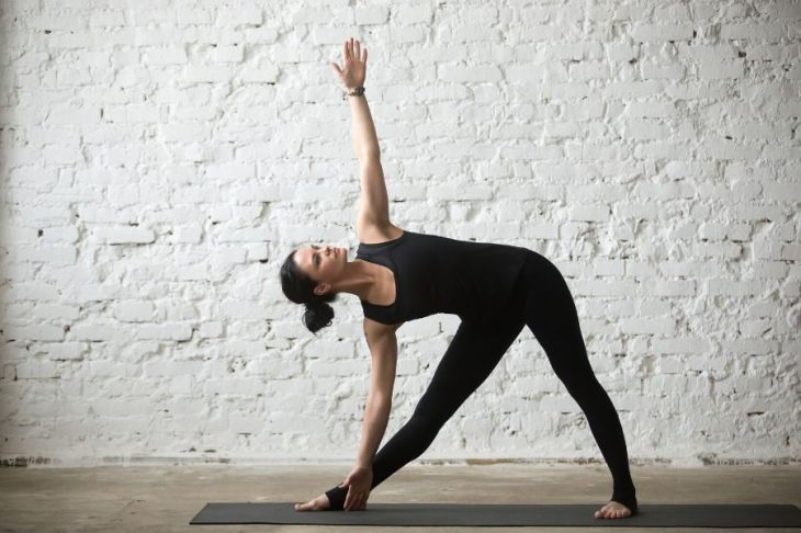 Triangle Pose strengthens your core, supporting confident posture.
