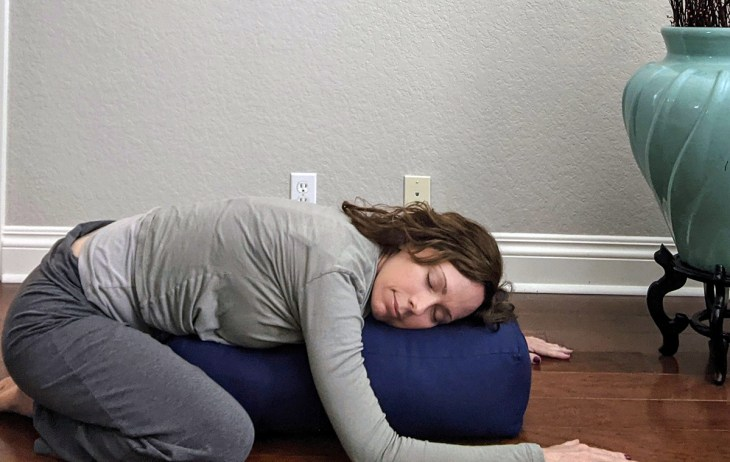 Supported Child Pose Yoga Fix for relaxation and destressing.