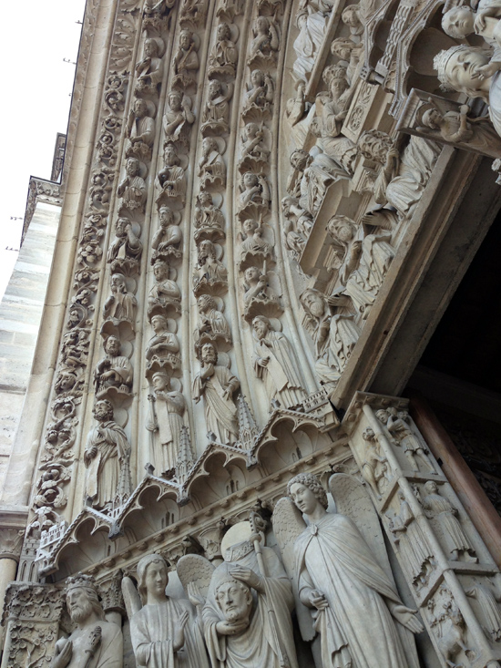 Carved detail above the doors of Notre Dame