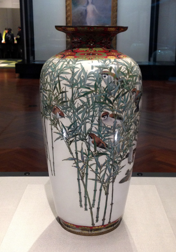 A beautiful vase with bamboo and lively sparrows