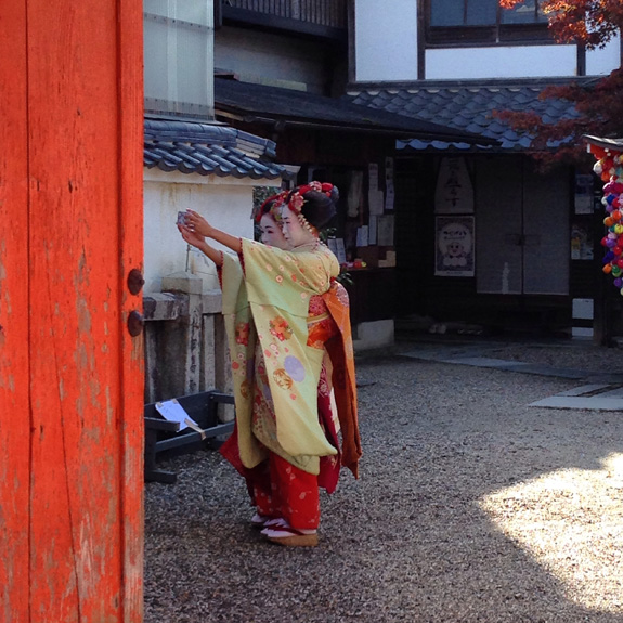 Geishas taking selfies