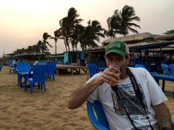 Jim Lundy enjoys a Flag beer on the beach.
