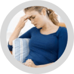 Unwell woman holding her head