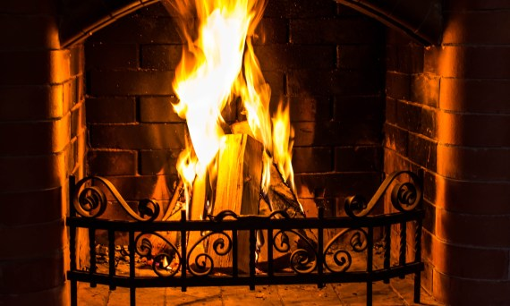 Fireplace with burning logs