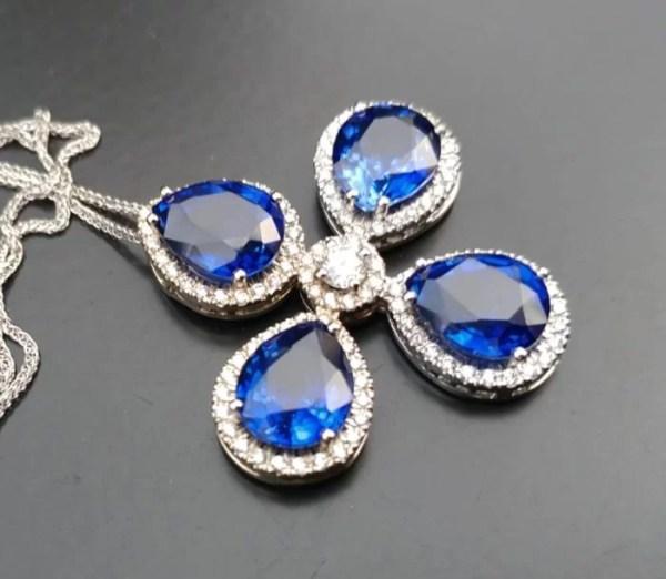 sapphire and diamonds cross pendant