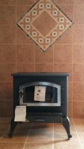 new wood burning stove and tile surround
