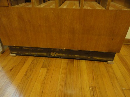 Bottom with big ugly glue residue from baseboards