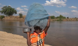 A young fisherman, Lugenda River. Photo: Rosey Perkins