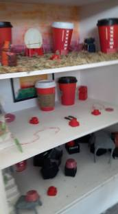 my red tea cups collected inside the Dolls house with my figure men.