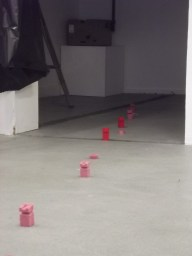 my four added wax candle made figures laid out in a line in the studio coming out of the projector room here!!!!!