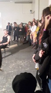 A man doing some performance art. Us the crowd watching.