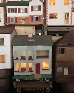 Showing a red door lights inside one dolls house so cute