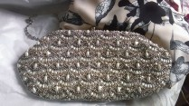 Pearl and beaded clutch bag from Accessorize.....with a glimpse of part of my outfit.