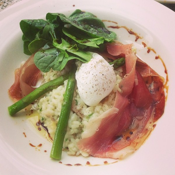 Mushroom risotto with prosciutto & shaved parmesan served with a poached egg, steamed asparagus and a salad