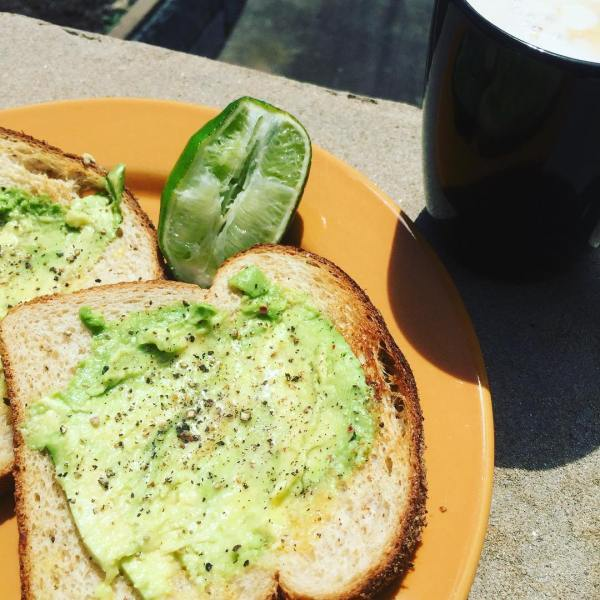Smashed avo & lime with a coffee in the sunshine