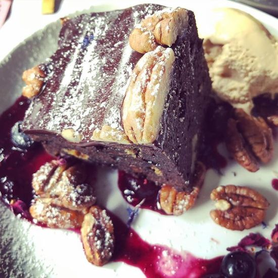 Chocolate Brownie with @barefootfarmbyron Maple Roasted Pecans & berry compote