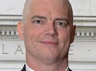 Bald Headshot of Ross (during chemotherapy)
