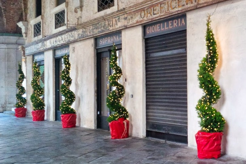 Christmas decorative trees placed by a historical jewellery shop in the Basilica Palladiana - Vicenza, Italy - rossiwrites.com