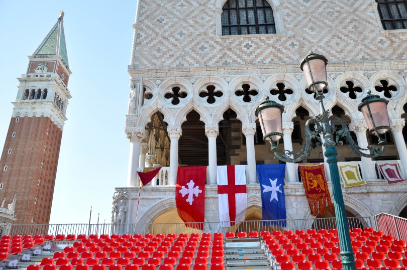 The stands in front of the Doge's Palace which is adorned with the flags of the four Maritime Republics, Venice, Italy