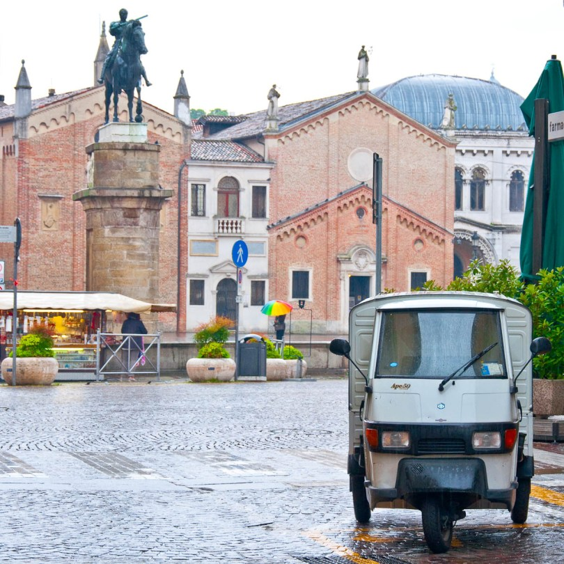 Ape50 and Donatello's equestrian statue in the rain, Padua, Veneto, Italy - www.rossiwrites.com
