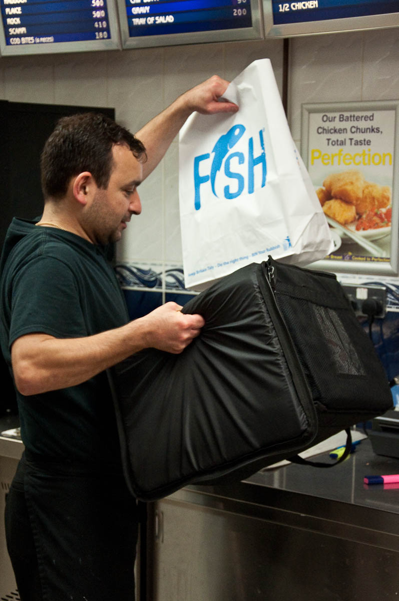 Packing a home delivery, The Master Fryer Fish and Chips Shop, St. Albans, England - www.rossiwrites.com