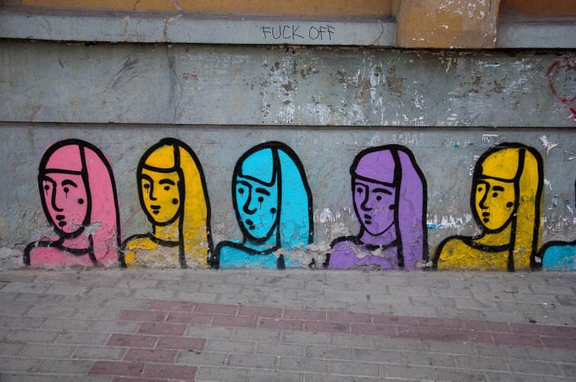 a-dilapidated-facade-with-crude-graffiti-varna-bulgaria-www.rossiwrites.com