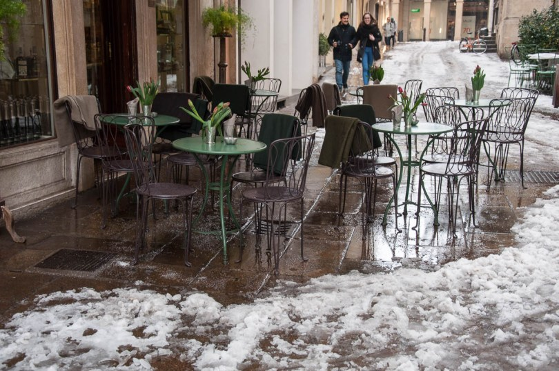 A cafe's outside seating area in the snow - Vicenza, Veneto, Italy - www.rossiwrites.com