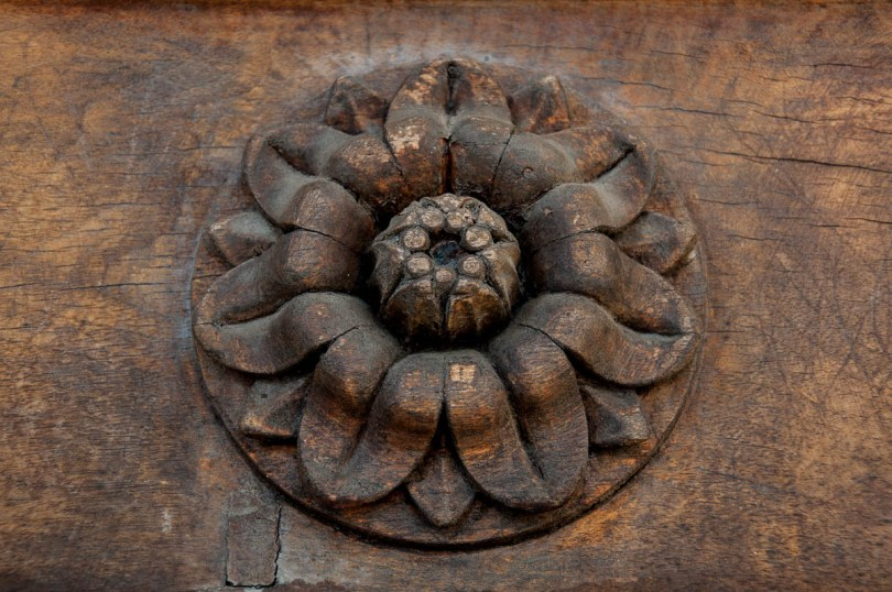 A close-up of a flower carved out of wood on the main gate of the Tempio Canoviano or the Temple of Canova - Possagno, Treviso, Veneto, Italy - www.rossiwrites.com