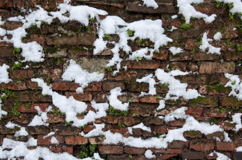 Snow hanging on a brick wall - Parco Querini, Vicenza, Veneto, Italy - www.rossiwrites.com