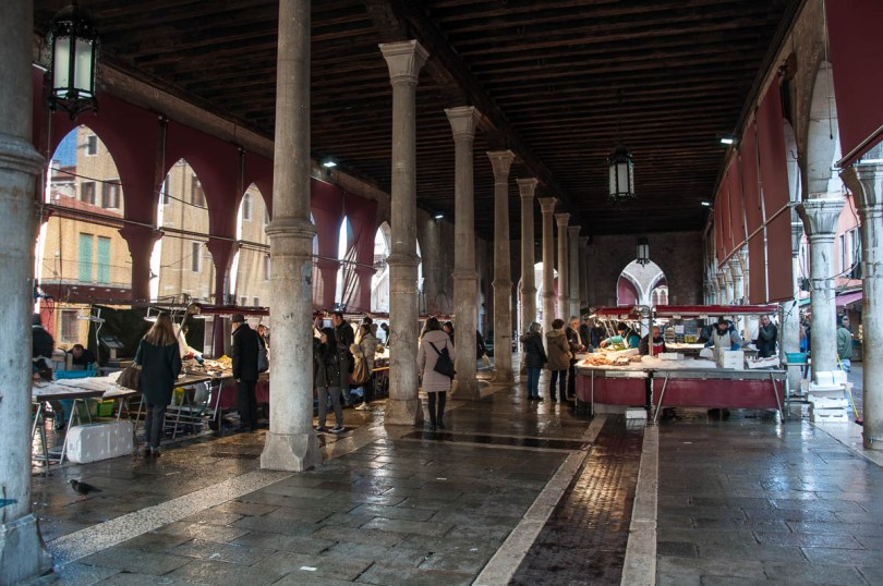 Shoppers and fishmongers' stalls in the big market hall - Rialto Fish Market, Venice, Italy - www.rossiwrites.com