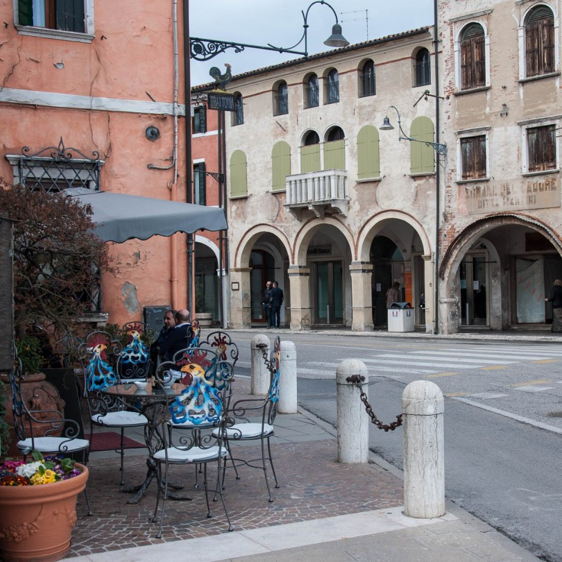 Rooster-inspired chairs in front of a local restaurant - Noale, Veneto, Italy - www.rossiwrites.com
