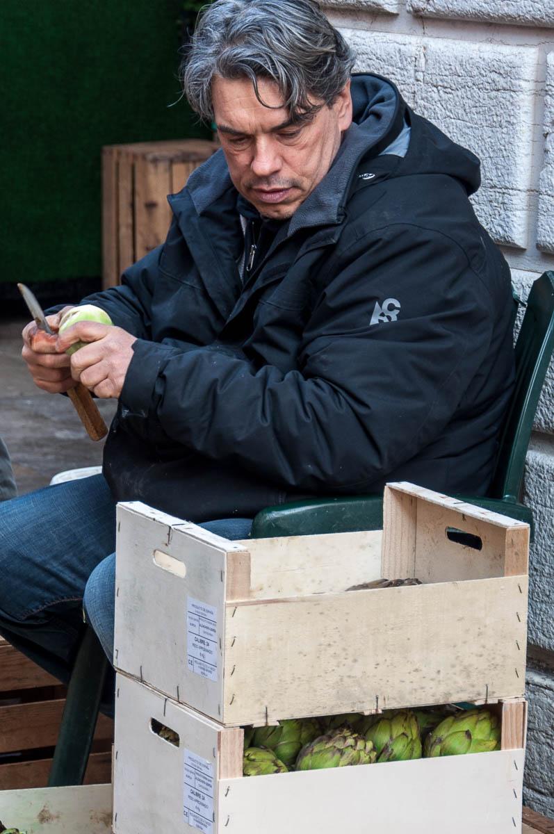 Trimming artichokes - Rialto Market, Venice, Italy - www.rossiwrites.com