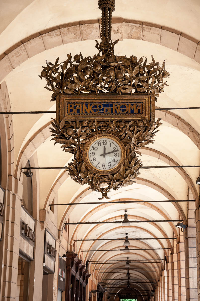 A large clock of Banco di Roma in one of Bologna's arcades - Bologna, Emilia-Romagna, Italy - www.rossiwrites.com