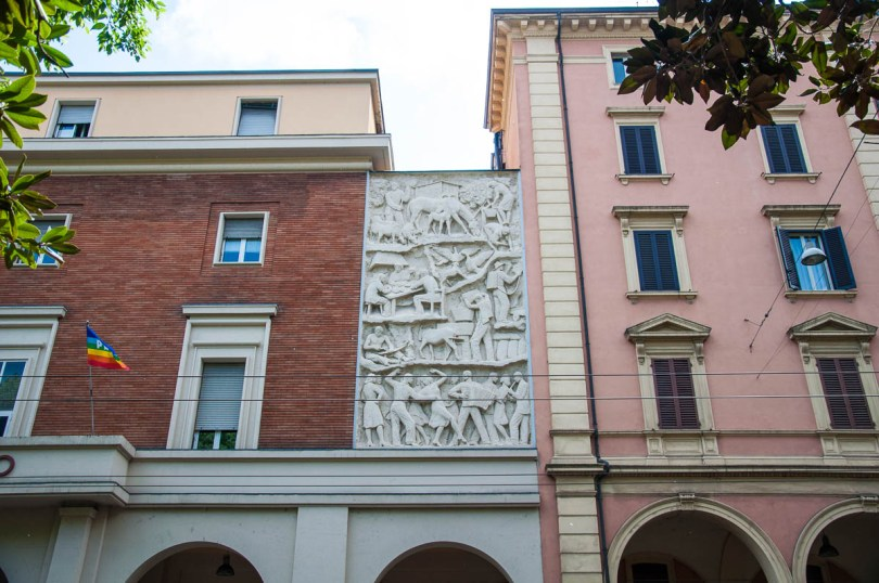 A stone bas-relief on large buildings - Bologna, Emilia-Romagna, Italy - www.rossiwrites.com