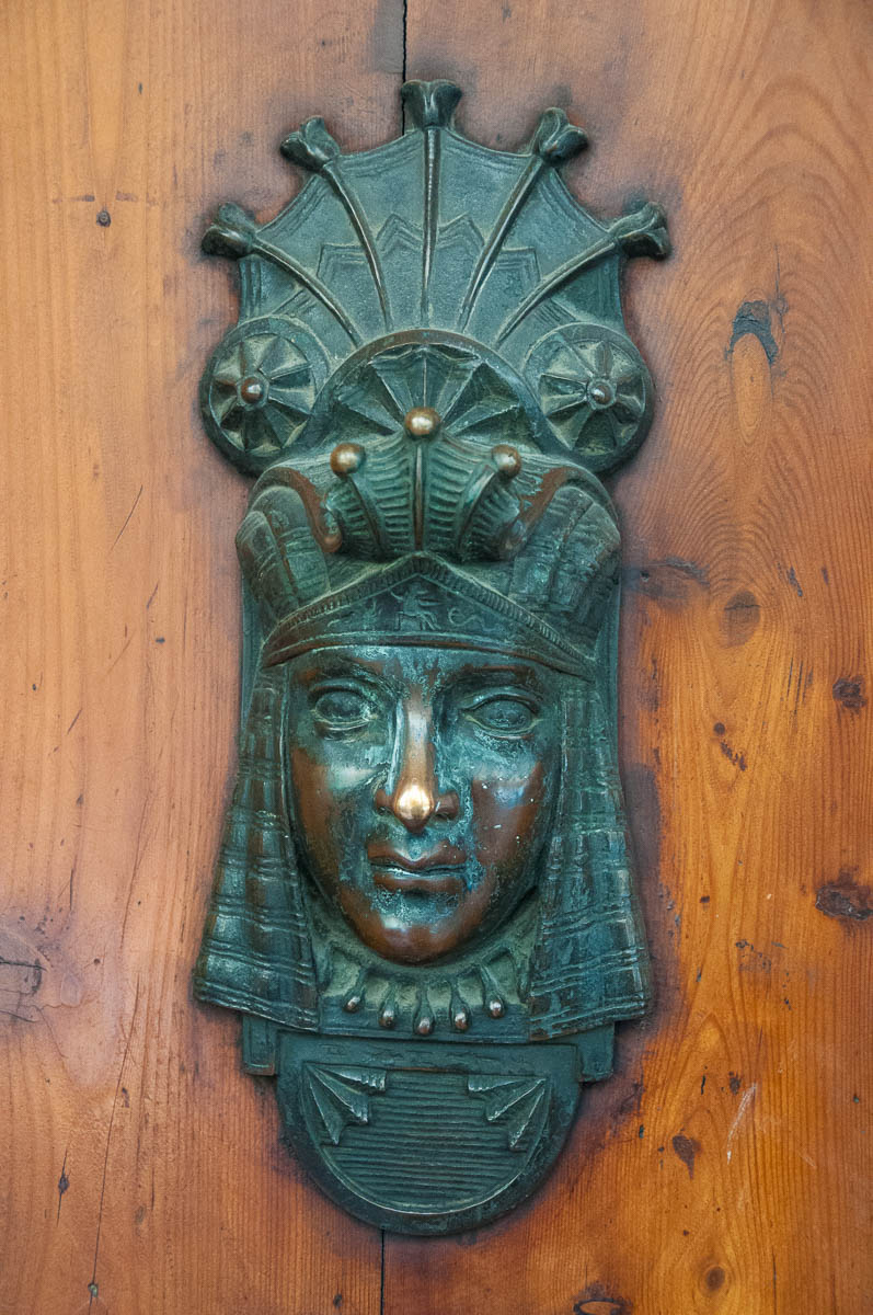 An Egyptian-inspired door knocker and lock - Bologna, Emilia-Romagna, Italy - www.rossiwrites.com