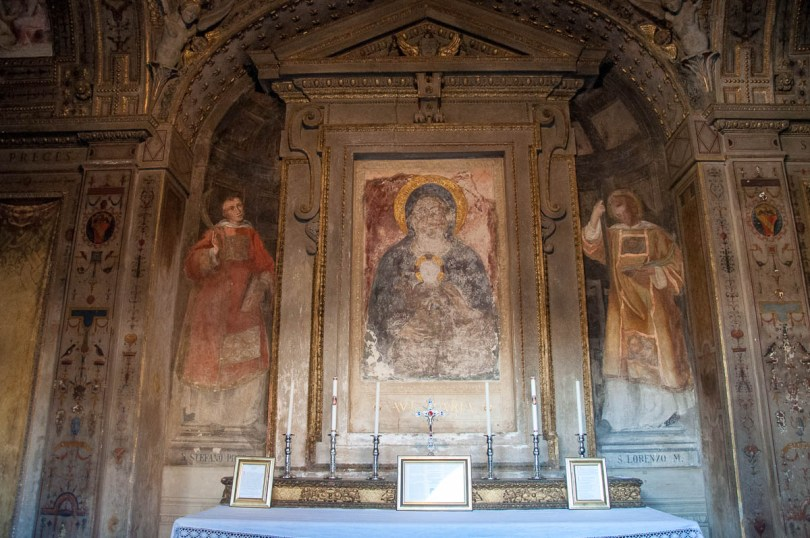 An altar covered with faded frescos - Basilica of Santo Stefano - Bologna, Emilia-Romagna, Italy - www.rossiwrites.com