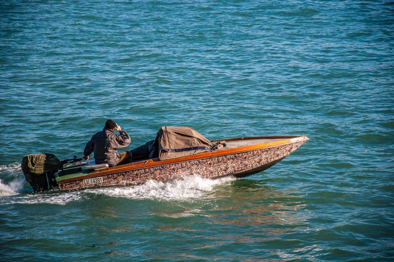 A Venetian man out and about with his boat - Venice, Veneto, Italy - www.rossiwrites.com
