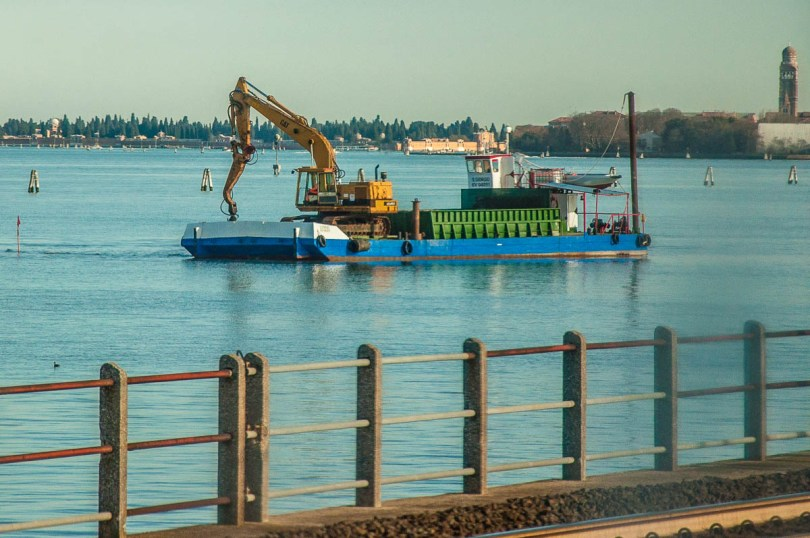 A digger on a platform in the Venetian lagoon - Venice, Veneto, Italy - www.rossiwrites.com