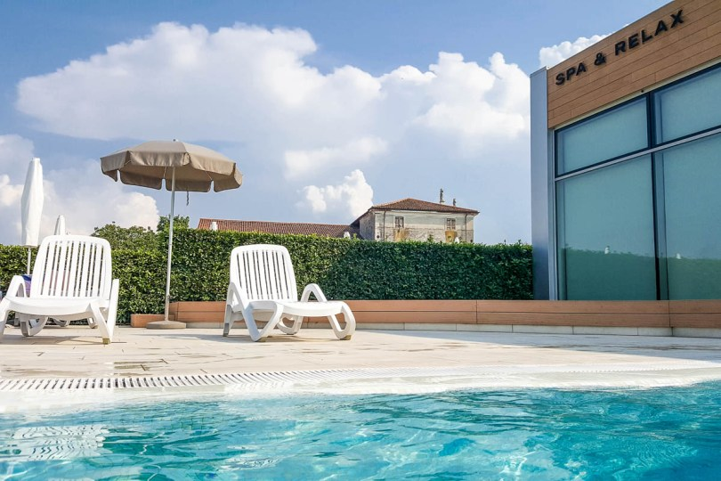 The pool area with the Wellness Centre building - Hotel Viest, Vicenza, Italy - www.rossiwrites.com