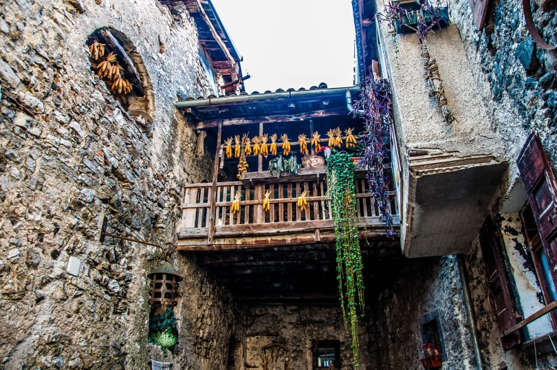 A balcony with corncobs in Canale di Tenno - Trentino, Italy - www.rossiwrites.com