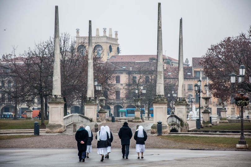 A group of nuns and priests walking on Prato della Valle - Padua, Italy - rossiwrites.com