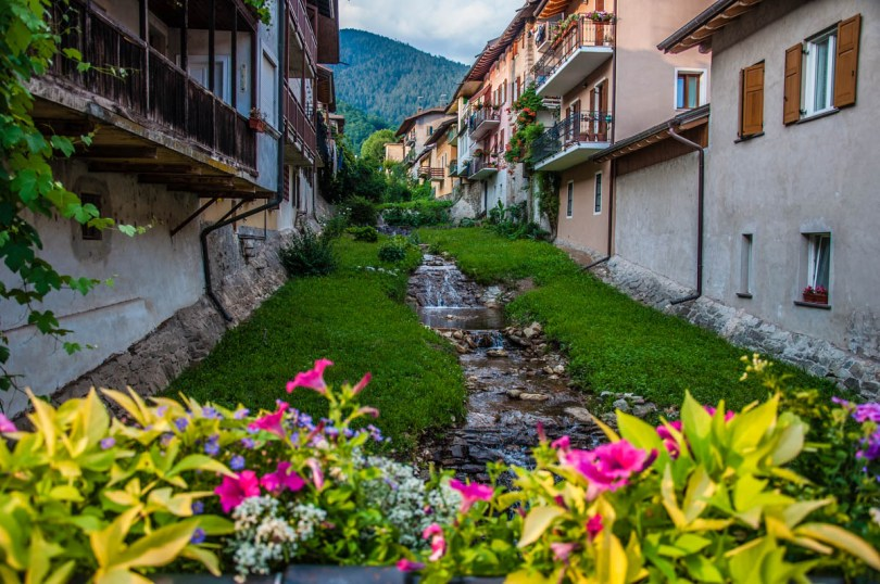 View of Levico Terme with flowers and a stream - Valsugana, Trentino, Italy - rossiwrites.com
