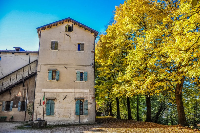 Feltre castle with trees in autumn - Feltre, Veneto, Italy - rossiwrites.com