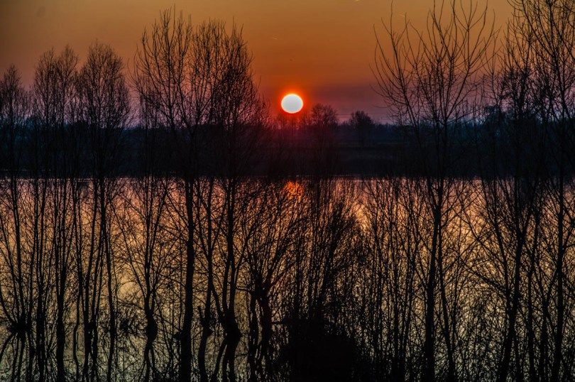 A fiery sunset over lake Camazzole - Province of Padua, Veneto, Italy - rossiwrites.com