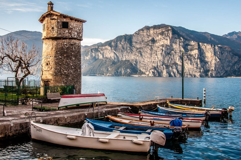 The harbour with the ancient windmill - Cassone, Lake Garda, Veneto, Italy - rossiwrites.com
